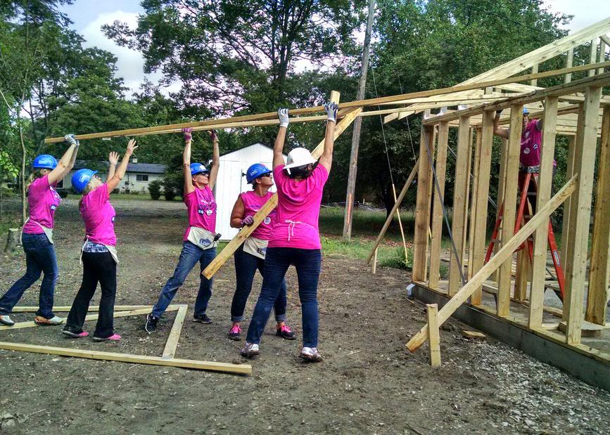 Women Build walls going up