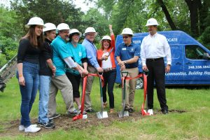 Major donors break ground with the Yanosy family - from left to right: Samantha Yanosy, Nick Yanosy, future homebuyers Mike and Natalie Yanosy, Bruce Trevarrow , Trevarrow Inc. President; Christine Ramaekers and Steve Ramaekers, Main Street Design Build; and Tim Ruggles, Habitat for Humanity of Oakland County Executive Director and CEO.